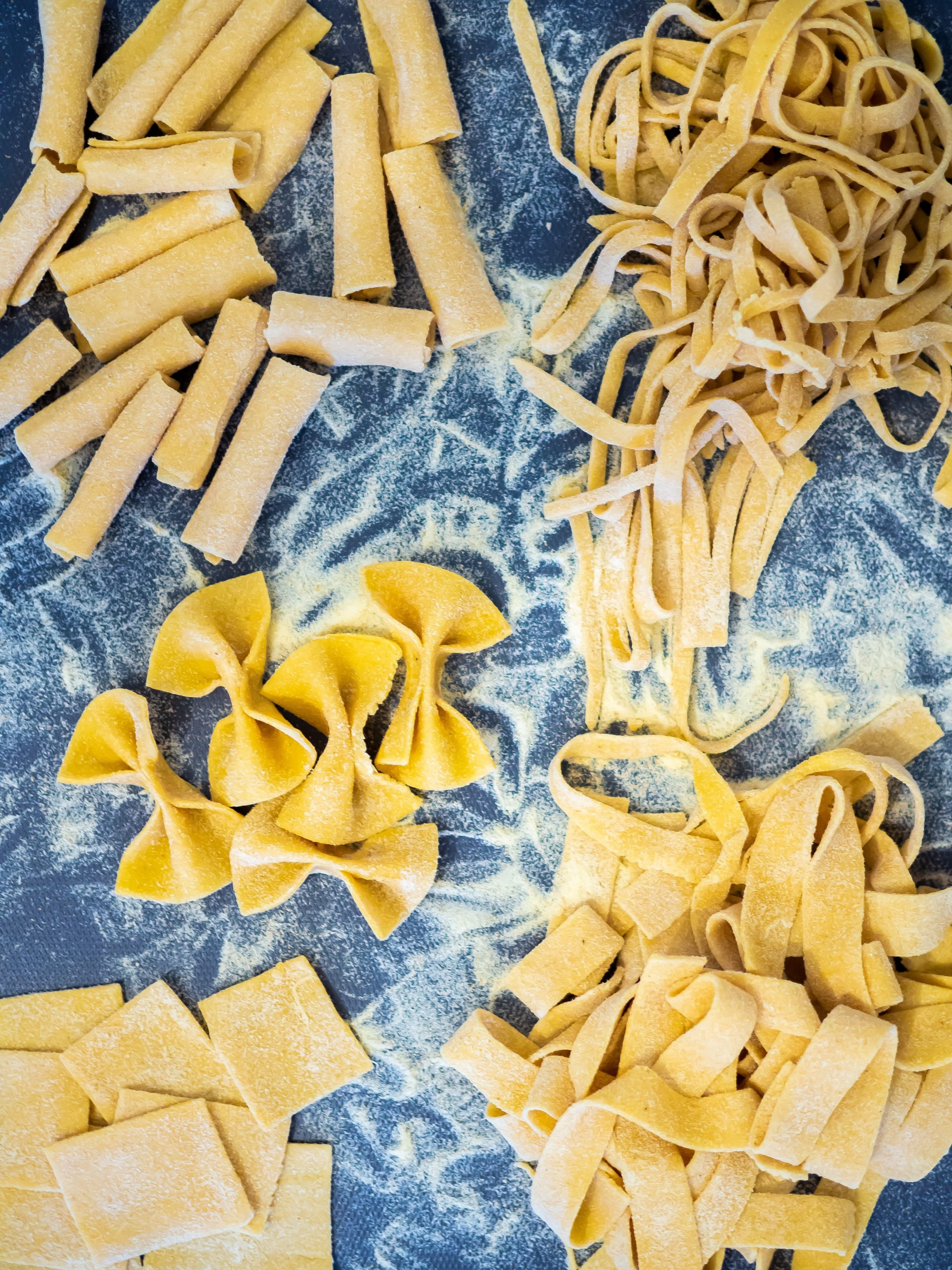 Home made pasta shapes - tagliatelle, farfalle, pappardelle